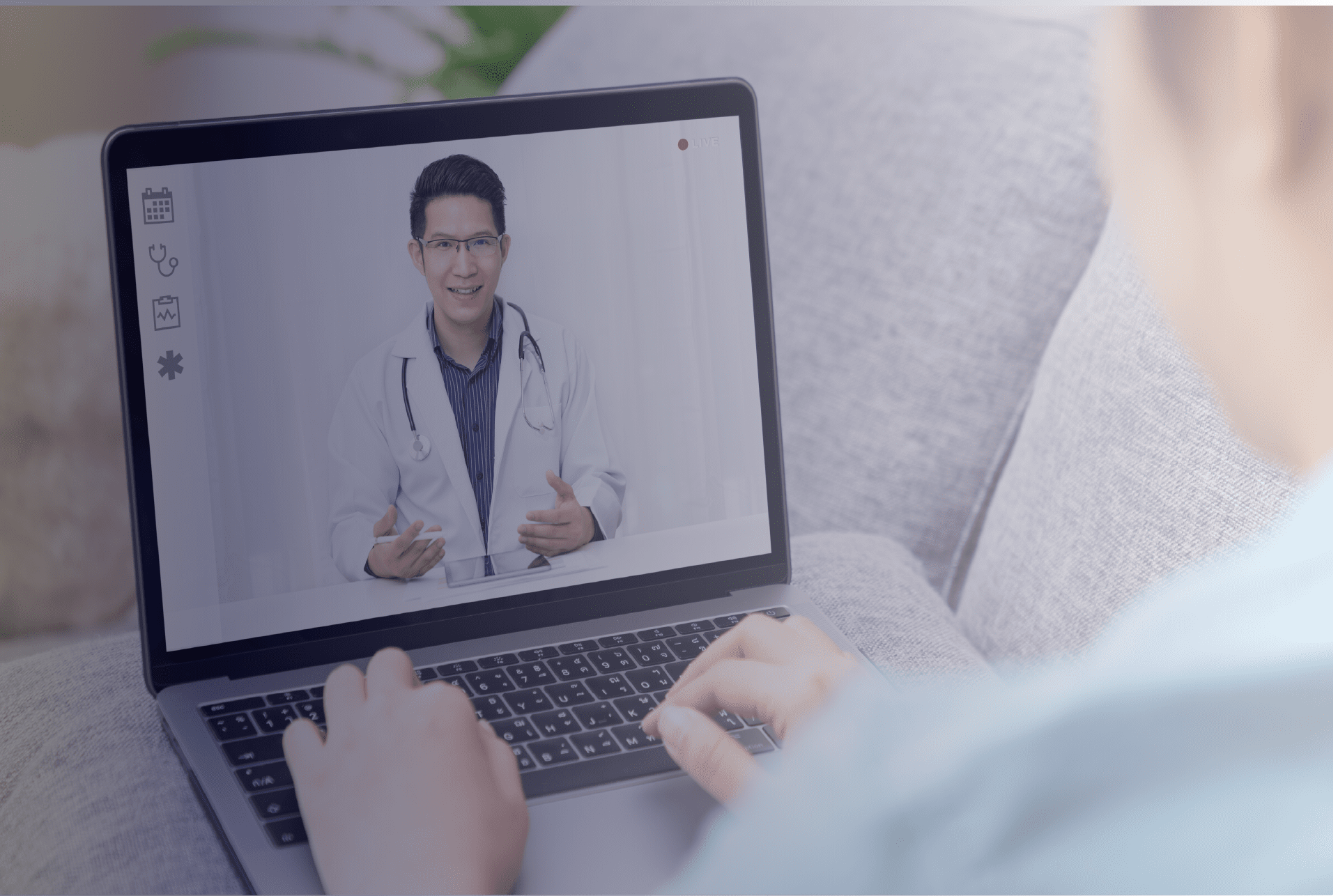 Asian male doctor on the laptop with active service vet during Telemedica telemedicine telehealth appointment to write nexus letters for veteran