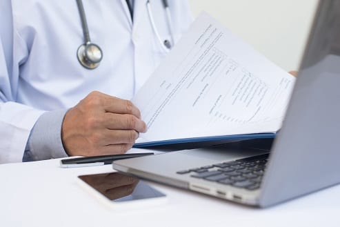 Male doctor on Telemedica telemedicine telehealth appointment to write nexus letters for veterans